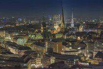 Germany, Hamburg, view from the tower of the St Michael's Church at the city by night — Stock Photo