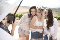 Friends on a road trip taking selfies with digital tablet — Stock Photo