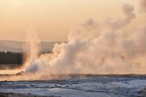 USA, Wyoming, Yellowstone National Park, steam rises in the Lower Geyser Basin at sunset — Stock Photo
