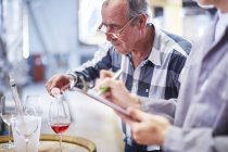 Winemakers testing wine blend in wine store — Stock Photo