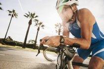 Spain, Mallorca, Sa Coma, triathlet training on bicycle — Stock Photo