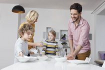 Family laying the table — Stock Photo