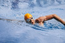 Male triathlet  swimming in a pool — Stock Photo