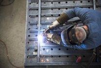 Metal construction, welder welding railing — Stock Photo
