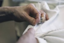 Hands of woman sewing, close-up — Stock Photo