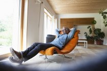 Confident mature man relaxing in armchair — Stock Photo