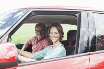 Portrait of happy mature couple together in car — Stock Photo