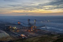 Germany, North Rhine-Westphalia, Grevenbroich, Garzweiler surface mine, Stacker in the evening — Stock Photo