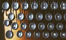 Typewriter keys on light blurred background — Stock Photo