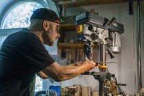 Knife maker in workshop at work — Stock Photo
