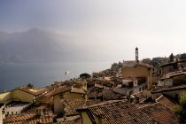 Italy, Lombardy, Brecia, Limone sul Garda, View over rooftops of the city — Stock Photo