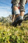 Austria, Tyrol, Tannheimer Tal, close-up of young couple hiking — Stock Photo
