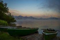 Morning light with boats at Hopfensee lake, Germany — Stock Photo