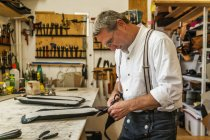 Saddler gluing padding for hippotherapy belt — Stock Photo