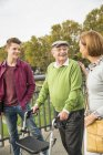 Senior man with daughter and grandson in park — Stock Photo