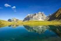 Germany, Bavaria, Allgaeu, Allgaeu Alps, Oy Valley, Lake Eissee, Mountain Grosser Wilder in the background — Stock Photo