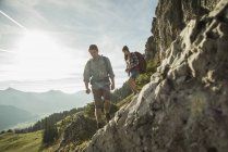 Austria, Tyrol, Tannheimer Tal, young couple hiking at rocks — Stock Photo