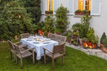 Autumnal laid table in garden in the evening — стокове фото