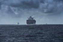 Spain, Andalusia, Tarifa, cargo ships on the ocean — Stock Photo