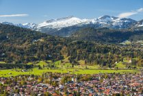 Germany, Bavaria, Allgaeu, View to Oberstdorf, in the background Hoher Ifen, Gottesacker Plateau, Toreck, Kleinwalsertal, Vorarlberg, Allgaeu Alps in Austria — Stock Photo