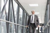 Businessman on jet bridge at the airport — Stock Photo