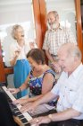 Senior people making music in a retirement village — Stock Photo