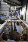 Two diesel mechanics at work in garage — Stock Photo