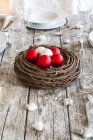 Laid table with Christmas baubles in wreath — Stock Photo