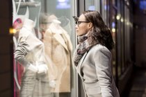 Young woman on shopping tour by night — Stock Photo