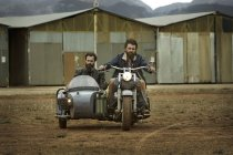Two men with full beards in motorcycle with sidecar — Stock Photo