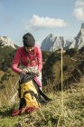 Austria, Tyrol, Tannheimer Tal, female hiker with backpack on alpine meadow — Stock Photo