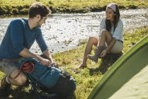 Austria, Tyrol, Tannheimer Tal, two young  hikers relaxing — Stock Photo