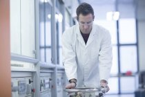 Young confident chemist working in lab — Stock Photo