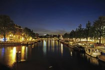 Netherlands, North Holland, Amsterdam, Amstel river at night — Stock Photo