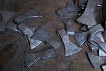 Work pieces of axes at historic blacksmith's shop — Stock Photo