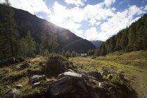 Austria, Tyrol, Kals am Grossglockner, landscape with rainbow — Stock Photo