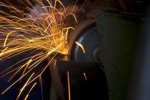 Sparkles at grinder in historic blacksmith shop — Stock Photo