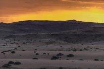 Africa, Namibia, Damaraland, vista verso praterie e vulcani entro il tramonto — Foto stock