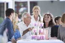 Three generations family celebrating grandfathers birthday in restaurant — Stock Photo