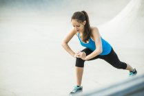 Young woman doing stretching exercises — Stock Photo