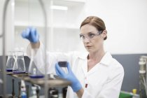 Scientist working with liquids in lab — Stock Photo