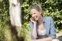 Happy woman on cell phone in rural landscape — Stock Photo