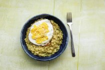 Dish of vegetarian kedgeree with fried egg — Stock Photo