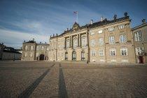Denmark, Copenhagen, Amalienborg Castle against sky — Stock Photo