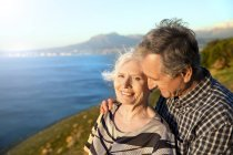 Portrait of happy senior couple  in front of the sea — Stock Photo