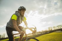 Germany, Mannheim, young man riding bicycle — Stock Photo