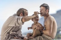 Gay couple with son outdoors — Stock Photo