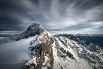 Austria, Schladming, Dachstein Mountains with south face of Hunerkogel in the foreground — Stock Photo
