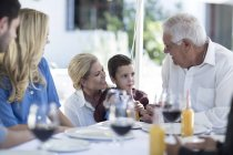 Mother, son and grandfather at family celebration — Stock Photo