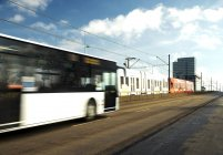Germany, Cologbe, Bus and tram crossing bridge — Stock Photo